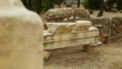 Rack focus shot of antique marble construction remains, archaeological finds Stock Footage