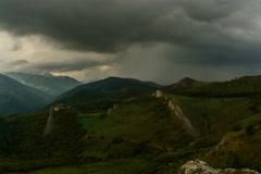 Rainstorm near Lita fortress ruins Transylvania landscape time lapse 6K Stock Footage