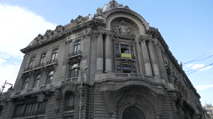 Old building with sculptural decorations in Bucharest Stock Footage