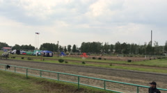 People on horses - Close shot of riders on horses on track in Siberia Stock Footage