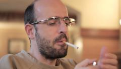 Nervous, tensed, bold man with glasses smoking cigarette, drinking coffee Stock Footage
