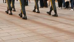 Soldiers boots close view, march on tiled pavement. Slow and coordinated steps - stock footage
