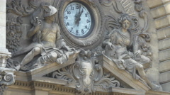 Clock and statues on CEC Bank building in Bucharest Stock Footage