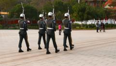 Soldier troop in parade uniform march away on square, Martyr Shrine Stock Footage