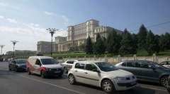 Driving cars by the Palace of Parliament in Bucharest Stock Footage