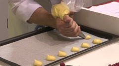 A pastry chef  prepares desserts with custard Stock Footage