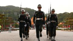 Sentinels march towards and stand, pan to changing guard Stock Footage