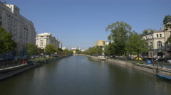 Driving cars along Dâmbovița River in Bucharest Stock Footage