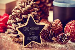 text good morning merry christmas in a star-shaped blackboard - stock photo