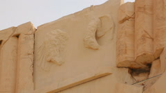 Classical Greek architecture detail, remains of stone relief on top of building Stock Footage