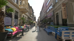 People walking on Stavropoleos Street in Bucharest Stock Footage