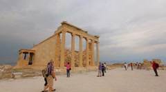 Many tourists visiting ruins of ancient temples, sightseeing tour, tourism Stock Footage
