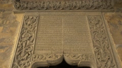 Bas-relief with old letters at Stavropoleos Church in Bucharest Stock Footage