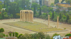 Huge marble columns, tourists viewing ruins of largest temple in ancient Greece Stock Footage