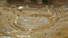 View from top at Dionysus Theater stage, amphitheater seats, tourist attraction Stock Footage