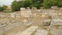 Group of teenage tourists enjoying sightseeing tour to ancient Agora of Athens Stock Footage