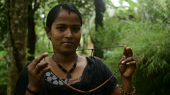 Indian Smiling Woman Holding Handmade Clay Jewellery Stock Footage