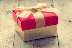 Stock Photo of Gift box on old wooden floor