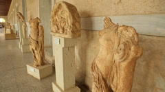 Stock Video Footage of Valuable remains of ancient marble statues exhibited at Stoa of Attalos museum
