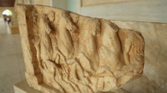 Stock Video Footage of Marble relief showing equestrians riding horses, exhibit at archeology museum