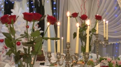Candles and roses on the table with lights in BG Stock Footage