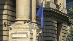 The European Union flag on CEC Bank building in Bucharest Stock Footage