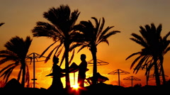 Silhouette Of A Loving Couple Kiss At Sunset - stock footage