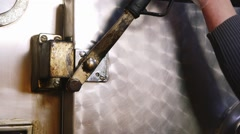 Open the valve on the large metal door refrigerator Stock Footage