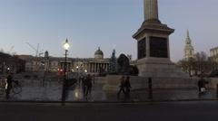 Trafalgar Square - London Buses go by Stock Footage