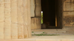 View inside remains of ancient temple, old marble columns, decaying stone walls Stock Footage