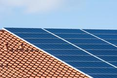 Innovative photovoltaic installation on the roof of a house Stock Photos