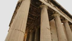 Group of senior tourists viewing marble columns of ancient Temple of Hephaestus Stock Footage