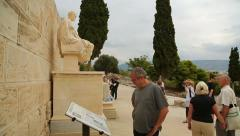 Tourists view statue of famous ancient Greek dramatist Menandre, sculpture art Arkistovideo