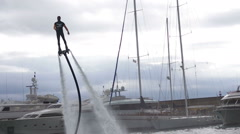 A demonstration of how you use a Flyboard-Jet pack during the Genoa Boat Show Stock Footage