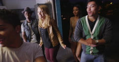 Moving through party as fun loving hipster friends act silly and fun dancing Stock Footage
