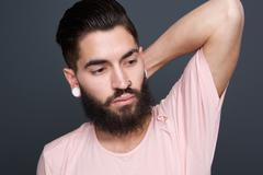 Fashion model with beard and piercing - stock photo