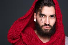 Male fashion model with wool scarf - stock photo
