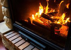 Close up of burning fireplace at home Stock Photos
