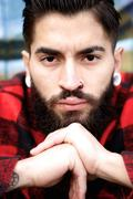 Young man with beard and piercing - stock photo
