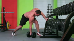 Workout for young bodybuilder. One Arm Dumbbell Row - stock footage