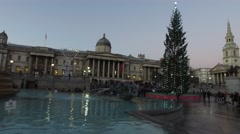 Trafalgar Square London - a smooth move round the fountain and Christmas tree Stock Footage
