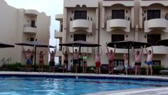 People jumping into the pool together Stock Footage