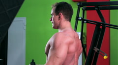 Workout for young bodybuilder. Wide-Grip Lat Pulldown - stock footage