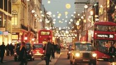 Oxford street in London with Christmas lights and traffic Stock Footage