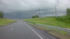 Travel by car in heavy rain on Altai Krai - stock footage