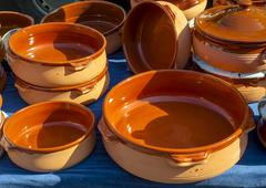 handmade terracotta containers used in Mediterranean cuisine - stock photo
