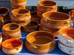 Handmade terracotta containers used in Mediterranean cuisine Stock Photos