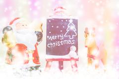 Santa Claus and Reindeer on color background for Merry Christmas celebration - stock photo