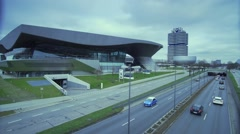 Modern building of the BMW company car and a boulevard in Munich Germany Stock Footage