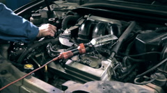 Stock Video Footage of Replacement of engine oil at service station